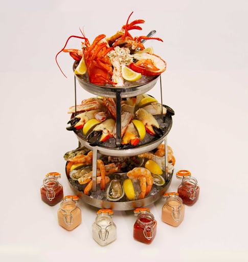 A seafood tower at the Magic Carpet al fresco eatery on deck 5 of Celebrity Edge.