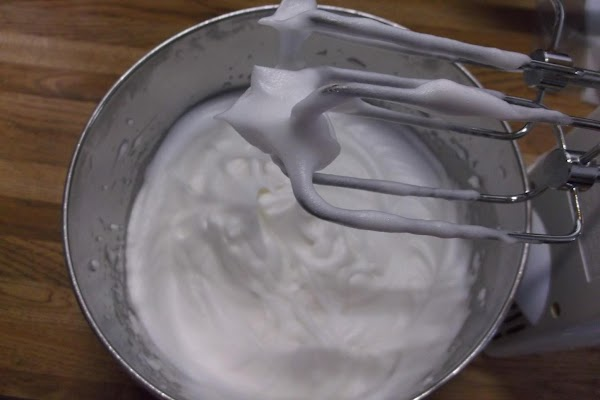 While continuing to beat, gradually add 5 tablespoons sugar and beat to stiff peaks.