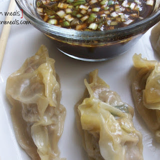 Steamed Wontons With Soy Scallion Dipping Sauce.