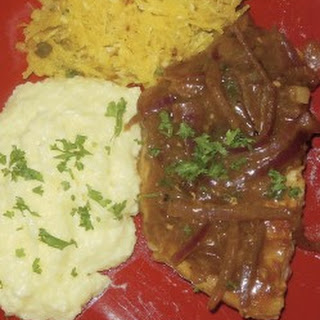 Smothered Pork Chops with Cheesy Grits
