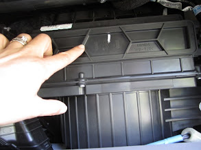 Photo: Locate the AIR FLOW wording on the air filter frame.