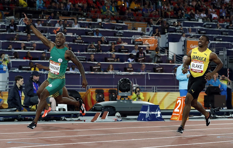Akani Simbine of South Africa streaks past Yohan Blake of Jamaica to win the Commonwealth Games 100m final at the Carrara Stadium, Gold Coast, Australia. Picture: REUTERS/PAUL CHILDS
