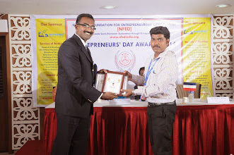 Photo: Guest of Honour Mr. Bobby A. Mathew Issuing Young Entrepreneur Award to Mr. Janarthanan V., Co-Founder & Managing Partner, Bonfirng, Coimbatore