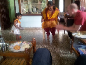 Photo: Kevin is playing with Madhavans sister's daughter as his sister looks on.