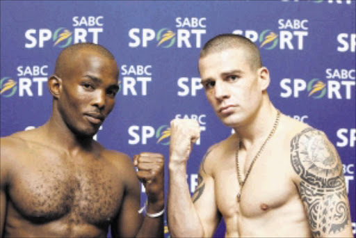 20100420AMU/BOXING. Junior Lightweight Champion,  Sipho Taliwe with Warren Joubert after the boxing press conference at SABC in Johannesburg. PIC : ANTONIO MUCHAVE .20/04/2010. © SOWETAN