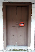 Photo: Old door with a new mail box in Mallorca, Malaysia.