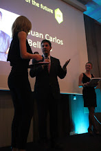 "Photo: Anna Lukanina presenting the C4F award ""Image of the Future"" to Juan Belloso"