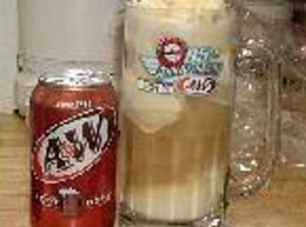 1. Pour 1/2 the root Beer into a tall glass.2.add 1 scoop of ice...