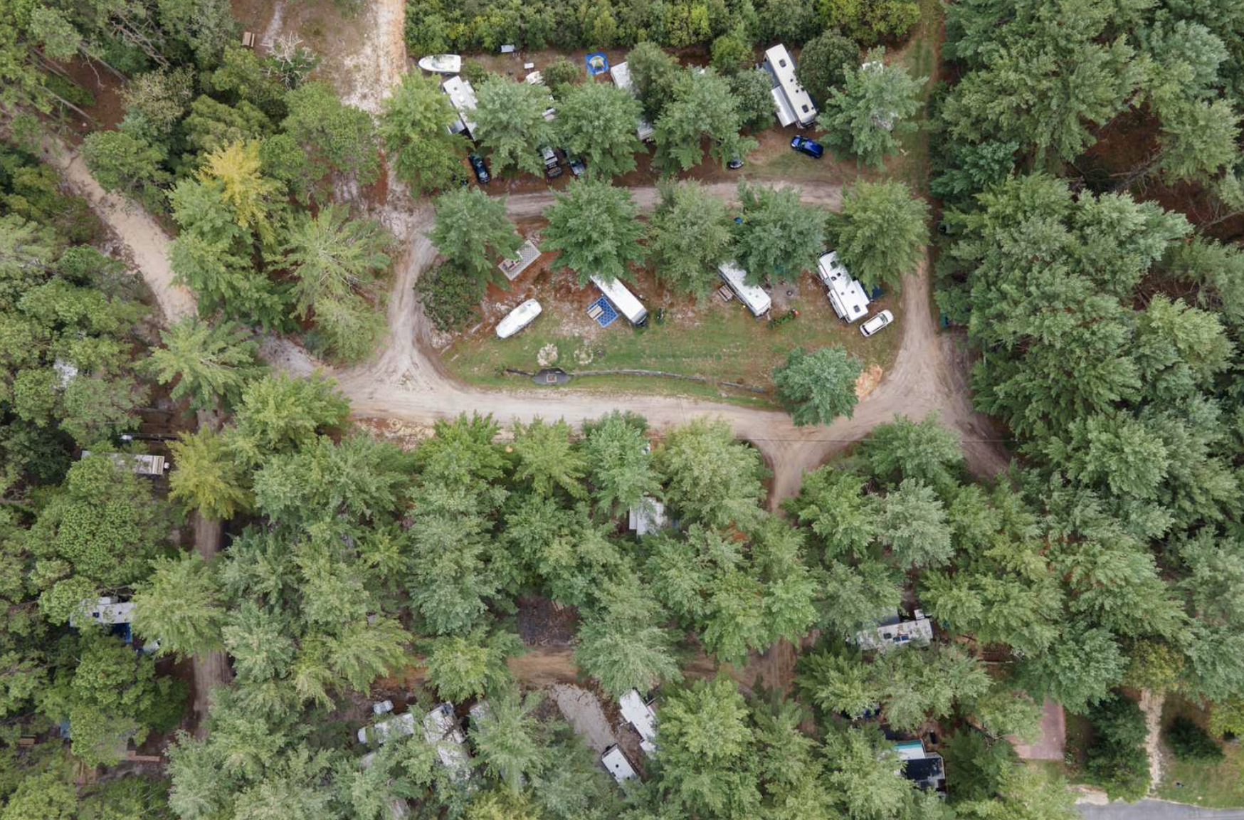 RVs parked in woods at Holly Acres campground