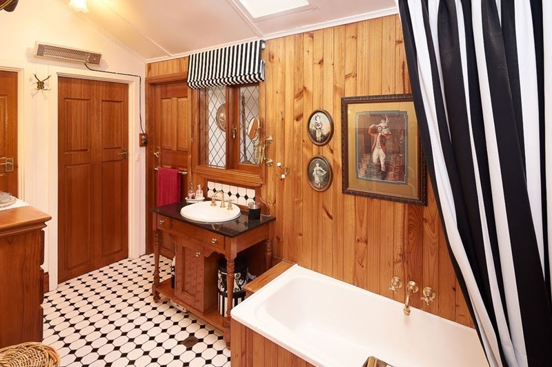 This bathroom has a Victorian style wash basin and Victorian geometic tiling.