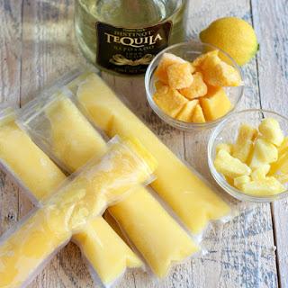 Boozy Mango Pineapple Popsicles.