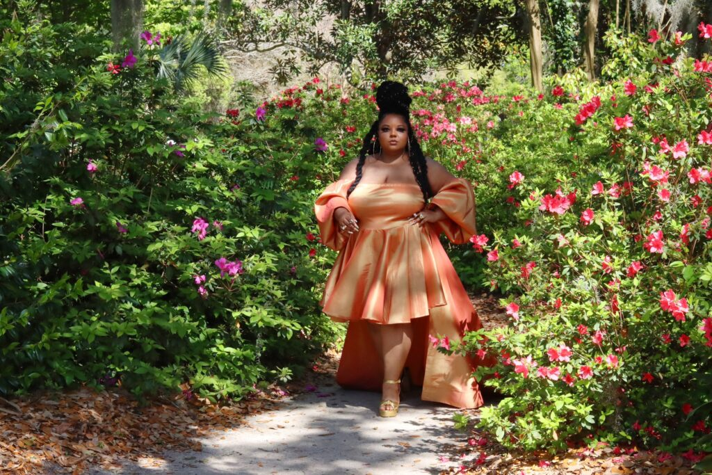 This image has an empty alt attribute; its file name is Courtney-Noelle-Plus-Size-Dresses-Ivy-Orange-Gown-with-Train-Front-View-1024x683.jpg