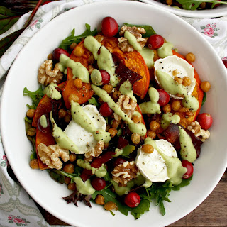 Warm Winter Salad with Pumpkin, Goat Cheese and Cranberries with Avocado Dressing