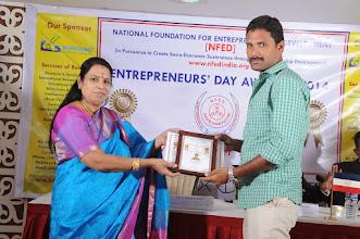 Photo: Chief Guest Dr. V. Padmavathy Issuing Young Entrepreneur Award to Mr.P.Ganesha Raja, Director, Sri Venkateswara Transports, Salem