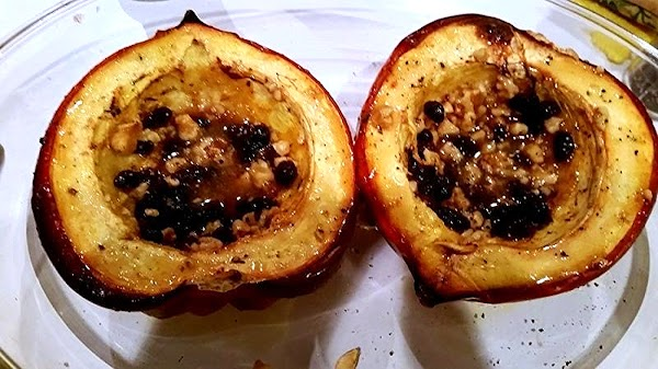 With a pastry brush, brush the inside and rim of squash with honey mixture....