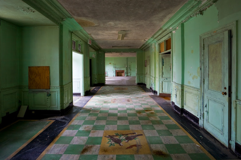Photo: #TuesDecay  The children's preventorium at Mont Alto Sanatorium - a building designed to contain and treat children who had been exposed to tuberculosis but were not yet symptomatic - has had a fascinating history. It only functioned in its intended capacity for about 25 years; later on, it became an insane asylum for women, a custodial asylum for mentally handicapped women, and finally a geriatric care facility for wards of the state. In 1986 it was finally abandoned. Mont Alto was the first public sanatorium in Pennsylvania, and while none of the original buildings remain - all were outmoded by the middle of the 20th century - many later additions still exist, including this disused building. Pictured here is the lobby and reception area, which includes three ornate insets in the floor - the seal of the Commonwealth, flanked on either side by the state birds.