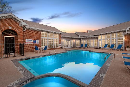StoneBridge at Bear Creek apartment swimming pool at dusk
