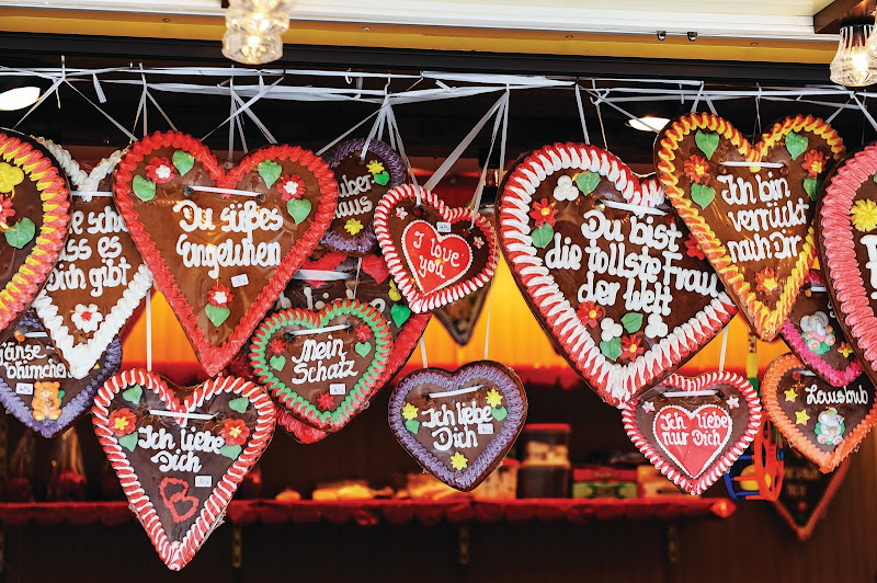 Decorated gingerbread cookies dangle from a festive stall