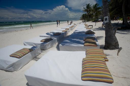 Cruise-Tulum17-1 - Beach beds, empty during the low season, beckon on Tulum Beach.