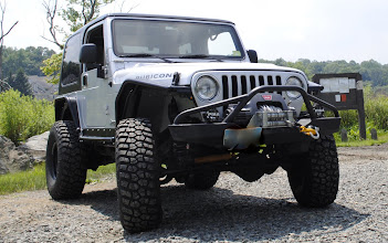 "Photo: Jeep Rubicon with Metal Cloak Fender system  3"" Tera Flex lift kit and 35"" BFG KM2 tires"
