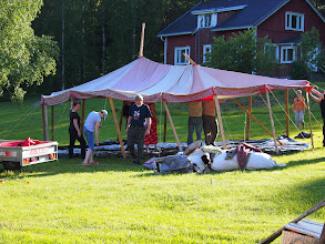 Photo: How many scadians does it take to set up a pavilion? Too many.