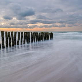 Sunset in France by Nico Sinselmeijer - Landscapes Waterscapes ( calais, sunset, long exposure, france, beach, poles )