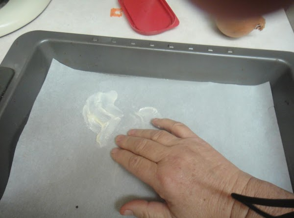 To get started grease or spray a pan.  Using parchment paper you spray...