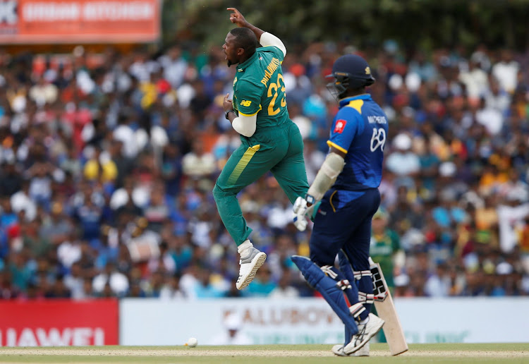 South Africa's Andile Phehlukwayo (L) celebrates after taking the wicket of Sri Lanka's Niroshan Dickwella (not pictured) during the Hero second of the five-match ODI series in Dambulla.
