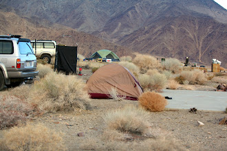 Photo: We may have gone slightly overboard with our site setup - Jim and his dad's slab in the rear was looking a bit like a yard sale.  The camp shower (black box there) was very functional, but with the chill breeze, it was a little uncomfortable once the hot water wasn't flowing.