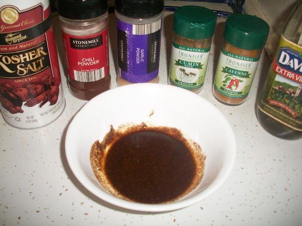 In a separate bowl, combine spices, then stir in olive oil.