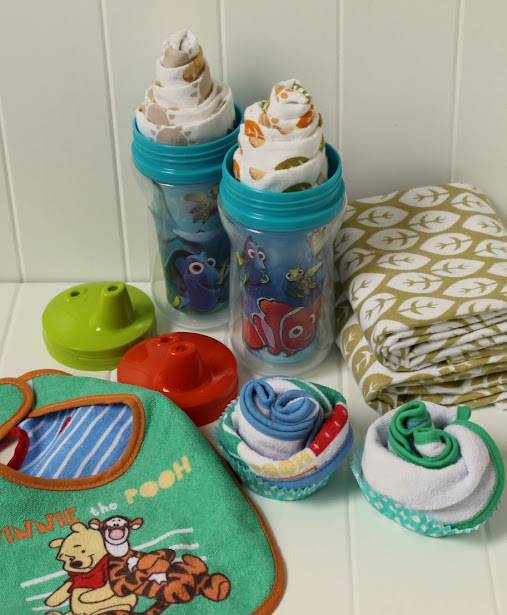 "Sprinkle some Disney Magic by making these easy Disney Baby DIY Baby Shower Gifts, like Disney Baby ""Milkshakes"" made from receiving blankets and Disney Baby ""Cupcakes"" made from bibs"