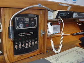 Photo: Our control panel and VHF radio. Our callsign is ZMT 3885