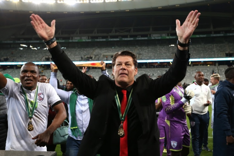 Free State Stars head coach Luc Eymael celebrates after his team beat Maritzburg United to win the Nedbank Cup trophy at Cape Town Stadium on May 19, 2018 in Cape Town, South Africa.