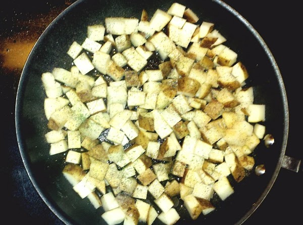Prepare potatoes: rinse off and cut into bite-sized cubes, cook in a frying pan...