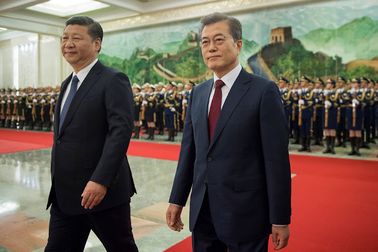 South Korean President Moon Jae-in and Chinese President Xi Jinping review the Chinese guard of honour during a welcome ceremony at the Great Hall of the People in Beijing, China, on December 14 2017. Picture: REUTERS