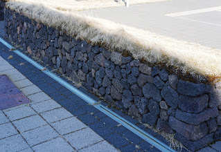 Photo: Stone wall in the parking lot