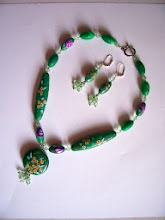 Photo: PCF-110 Polymer Clay hand made beads. Green pearl plus yellow daisy, purple rose and butterflies. Necklace and earring set. $109.00
