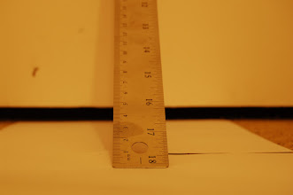 Photo: The lens is 55mm, and aperture is at f/5. Camera lens is sitting 310mm from the end of the ruler, so N = 5.6, f = 55, and U = 310. My Nikon D50 sensor size (according to dpreview.com) is 23.7 x 15.5mm, so assuming a circle of confusion of (1.5/1000)*23.7, C = 0.035mm.  Plugging into the DoF equation, (5.6 * 310^2 * 0.035)/(55^2) = 6.23mm. At an angle of 45 degrees, DoF = square-root of 2 * 6.23mm = 8.81mm. The photo looks to be in focus between 0mm and 7mm, so it's close!