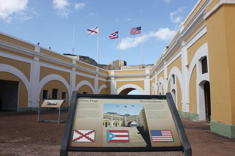 The Three Flags monument at El Morro, representing the U.S. flag, the Puerto Rico flag and the Cross of Burgundy flag, a Spanish military flag that flew here from 1539-1785.