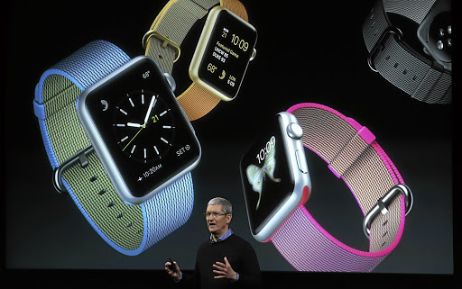 Apple has successfully moved from producing computers to selling game-changing cellphones, tablets and ways of buying music. Here CEO Tim Cook demonstrates the Apple Watch at a presentation last year. Picture: GETTY IMAGES