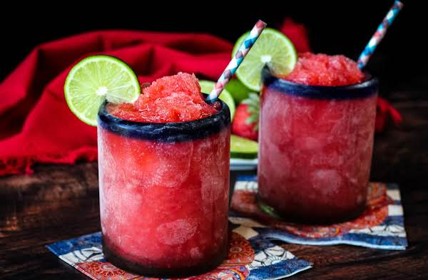 Two Glasses Of Strawberry Lime Slush.