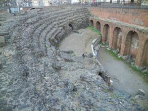 Photo: Wandering around Catania ... another Roman Amphitheater, this one right smack in the middle of the city, like the one we saw in Lecce but only a corner of this one was preserved.