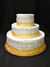 Photo: Smooth wedding cake w/gold ribbon wrap & traditional borders around tops. 3-dot cluster border around sides.