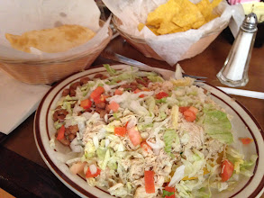 Photo: At Sadie's of New Mexico with best traditional New Mexican dishes like this one with pinto beans, chicken, tortilla chips and the local speciality a small cushion like bread, the sopapilla.