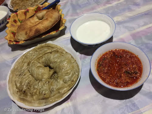 Travel to Tajikistan Pamir Highway and Wakhan Corridor // Rolled stuffed pastry Oromo