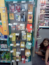 Photo: As I turned the corner I found another display I would love to have in my room, look at all these lip balms! Oh and my daughter, Bella, still looking at the Wet N Wild display!