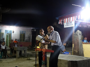 Photo: Brother Merle preaching at Hari Keempat village with Iwan as his interpreter. At every service there were large responses and this service was no exception. We were so busy praying for all the responses that we failed to get a picture.