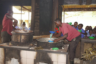 Photo: Cooks distributing lunch