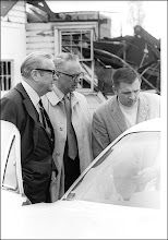 Photo: Portage County Prosecutor Ron Kane, right, enters car before Governor Rhodes.