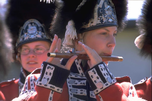 A tradition of St. John's, Newfoundland, a cadet plays fife in the Signal Hill Tattoo, which reenacts the Royal Newfoundland Regiment of Foot 1795.
